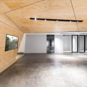 These plywood panels all intersect here architecture, ceiling, daylighting, floor, flooring, hardwood, home, house, interior design, laminate flooring, loft, real estate, tile, wood, wood flooring, white, orange