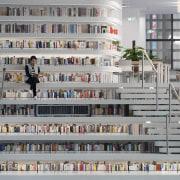 Deep shelves at the Tianjin Binhai Library Tianjin building, gray