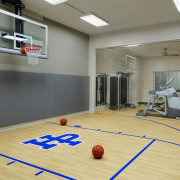 This basketball court/gym means you don't need to basketball court, floor, flooring, games, hardwood, indoor games and sports, interior design, laminate flooring, leisure centre, recreation room, room, sport venue, sports, structure, wood, wood flooring, gray, orange