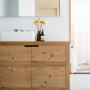 The timber continues into the bathroom bathroom, bathroom accessory, bathroom cabinet, cabinetry, chest of drawers, countertop, drawer, floor, furniture, kitchen, product design, sideboard, sink, tap, wood, white