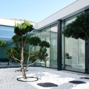 You can look right through to the office, architecture, courtyard, facade, house, property, window, white