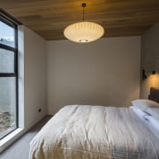 Arrowtown-based Bennie Builders was the only Southern Lakes architecture, bed frame, bedroom, ceiling, daylighting, floor, home, house, interior design, light fixture, lighting, property, real estate, room, wood, black, gray