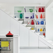 Hidden storage lines the staircase furniture, interior design, product, product design, shelf, shelving, white