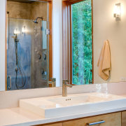A (semi) private bathroom features a substantial mirror bathroom, bathroom accessory, bathroom cabinet, countertop, home, interior design, plumbing fixture, room, sink, gray
