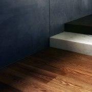 Contrasting materials meet here floor, flooring, hardwood, laminate flooring, property, wood, wood flooring, wood stain, black