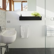 The light, white bathroom is certainly quite inviting architecture, bathroom, bathroom accessory, bathroom cabinet, bidet, floor, home, interior design, plumbing fixture, product, product design, property, room, sink, tap, tile, toilet, toilet seat, wall, white