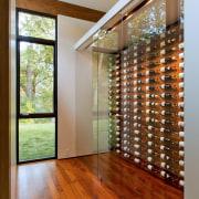 This wine storage area is almost set up ceiling, door, floor, flooring, hardwood, home, house, interior design, laminate flooring, real estate, wall, window, wood, wood flooring, wood stain, brown