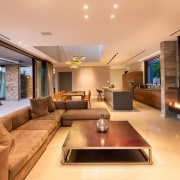 Inside the home, the living room shares the ceiling, home, interior design, living room, property, real estate, room, orange