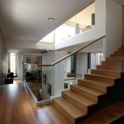 Wood, concrete and glass create an interesting space architecture, ceiling, daylighting, floor, flooring, handrail, hardwood, house, interior design, lobby, property, real estate, stairs, wood flooring, gray, black, brown