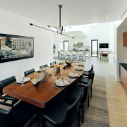 The dining area sits off to the side ceiling, dining room, interior design, living room, real estate, room, table, gray