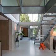 A view of the entry way and glass architecture, ceiling, condominium, daylighting, estate, house, interior design, lobby, loft, real estate, gray, black