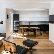 There's an easy flow between the kitchen, dining apartment, floor, flooring, interior design, living room, real estate, room, white