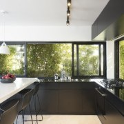 Greenery surrounds the kitchen architecture, countertop, daylighting, estate, house, interior design, property, real estate, window, white