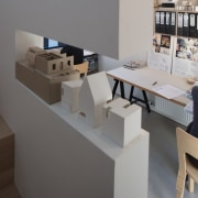 A view of the studio from the staircase architecture, desk, furniture, interior design, product design, table, gray, black