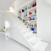 This staircase looks like it folds up into architecture, furniture, interior design, product, product design, shelf, shelving, white