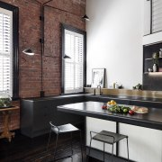 Lights hang out from various points on the countertop, interior design, kitchen, loft, table, black, white