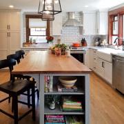 By choosing not to hide the extractor, the cabinetry, countertop, cuisine classique, floor, flooring, hardwood, interior design, kitchen, laminate flooring, room, wood flooring, gray