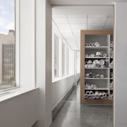 Polished concrete floors run throughout this space floor, interior design, white, gray