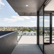 This terrace wraps around the upper level of architecture, building, condominium, daylighting, house, real estate, window, white, gray