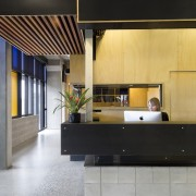 The lobby features multiple contrasting elements architecture, ceiling, floor, furniture, house, interior design, lobby, product design, table, black, gray
