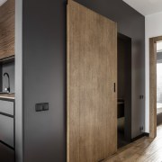 Architect: MetaformaPhotography by Krzysztof Strażyński floor, interior design, wall, wood, wood flooring, black, brown, gray