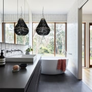 A view through the bathroom out to the architecture, ceiling, countertop, floor, flooring, home, house, interior design, kitchen, room, window, white