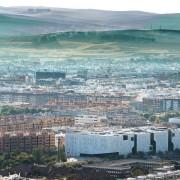 Palace of Justice building | Mecanoo + Ayesa aerial photography, bird's eye view, city, cityscape, horizon, metropolis, mountain, panorama, residential area, sky, skyline, suburb, urban area, gray