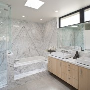 Marble clearly delineates the the wet area of bathroom, ceiling, countertop, floor, flooring, home, interior design, room, tile, wall, gray