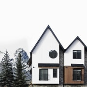 Tall and narrow, the lodge is a perfect architecture, building, cottage, elevation, facade, home, house, property, real estate, roof, siding, sky, window, white