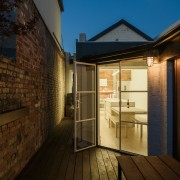 This cozy deck area makes the most of architecture, daylighting, facade, home, house, lighting, property, real estate, residential area, roof, sky, window, brown, black