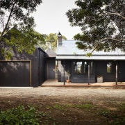 A single garage sits alongside the house architecture, cottage, facade, farmhouse, home, house, property, real estate, residential area, tree, black, brown