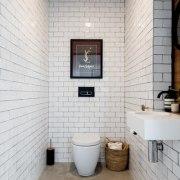 This tiled bathroom keeps things clean bathroom, floor, flooring, interior design, plumbing fixture, room, tile, wall, white, gray