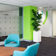 Plant, meet green pillar ceiling, furniture, interior design, office, product design, table, wall, white