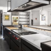 A variety of heights and the mix of countertop, home appliance, interior design, kitchen, gray, black