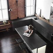 Ample space for entertaining and preparing meals countertop, desk, floor, flooring, furniture, hardwood, interior design, living room, product design, room, table, wood, black, white