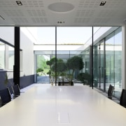 This conference room faces the courtyard architecture, conference hall, daylighting, glass, interior design, lobby, office, real estate, window, white, gray
