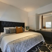 This bedroom has an open connection to the bed frame, bedroom, ceiling, estate, hotel, interior design, real estate, room, suite, gray