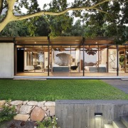 The tidy grounds perfectly match the home architecture, backyard, courtyard, house, outdoor structure, real estate, gray