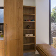 Arrowtown-based Bennie Builders was the only Southern Lakes cabinetry, chest of drawers, cupboard, furniture, interior design, shelf, shelving, wardrobe, wood, brown, gray