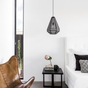 A hanging pendant light sits over this end furniture, home, interior design, lamp, light fixture, lighting, lighting accessory, living room, product design, table, wall, white