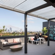 A partially covered terrace provides views of the interior design, outdoor structure, property, real estate, roof, white
