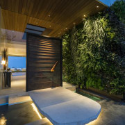 A floating access path is held up by architecture, backyard, daylighting, estate, home, house, interior design, landscape lighting, lighting, property, real estate, sky, swimming pool, brown, black