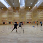 There's ample for multiple games competition event, flooring, fun, leisure, leisure centre, sport venue, sports, structure, gray, brown