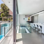 Glass balustrades wrap around the glass staircase architecture, daylighting, handrail, house, interior design, property, real estate, gray, white