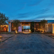 Recessed lighting illuminates the garage doors architecture, backyard, cottage, estate, evening, facade, home, house, landscape, landscape lighting, lighting, property, real estate, residential area, sky, teal, blue