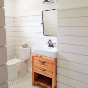 The wood vanity stands out in this bathroom bathroom, bathroom accessory, bathroom cabinet, chest of drawers, drawer, floor, flooring, furniture, hardwood, plumbing fixture, product, product design, room, shelf, sink, tap, tile, wall, wood, gray