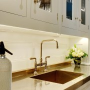 A polished countertop reflects the fittings and lights bathroom, countertop, interior design, kitchen, room, sink, tap, orange
