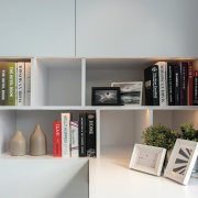 A closer view of the shelving in the bookcase, furniture, interior design, office, product design, shelf, shelving, gray