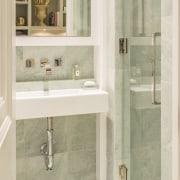 Very faint aquamarine tiles line this compact bathroom bathroom, bathroom accessory, bathroom cabinet, floor, flooring, interior design, plumbing fixture, room, sink, tap, tile, wall, window, white, orange