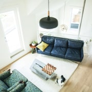 A view down into the lounge couch, floor, furniture, home, house, interior design, living room, property, room, table, wood, white